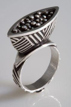Dimensional geometric ring by Terry Kovalcik.