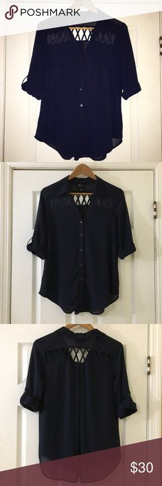 BCX Navy Blue Sheer Blouse w/ 3/4 Cuffed Sleeves Used once or twice but in Like New Condition! Beautiful navy blue sheer BCX blouse with cuffed 3/4 sleeves. Button-up in the front and cute criss-cross detail on the back. Goes great with a pair of jeans or white pants! Size M. Please review all photos and ask any questions prior to purchase. Thank you for visiting my closet!  BCX Tops Button Down Shirts