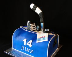 do something like this for my birthday but take out the puck and hockey stick  for pom-poms and keep the skate :)