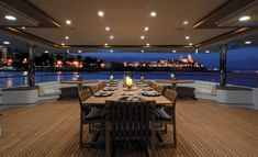 Dining on deck night superyacht MARAYA