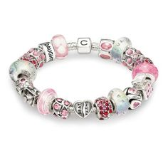 Pink and White Snap Chamilia Bracelet .. only have 3 charms at the moment. will be working my way to this :)