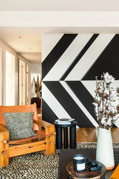 Inside 75 Kenmare, Lenny Kravitz's First New York City Building Design graphic black and white wall with chair in front Lenny Kravitz, Milo Baughman, Metal Countertops, New York City Buildings, Black Side Table, Kare Design, Architectural Digest, Design Firms, White Walls