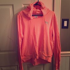PINK by Victoria's Secret hooded sweatshirt. Light coral colored hooded sweatshirt in a light coral color by PINK. It is a size large in excellent condition. PINK Victoria's Secret Tops Sweatshirts & Hoodies