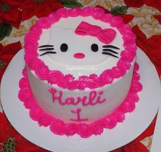 Hello Kitty head is a 3 layer, chocolate cake with cream cheese filling, iced in buttercream with fondant whiskers  eyes. The matching smash cake is a 6 chocolate cake w/cream cheese, iced in buttercream w/a fondant hello kitty head  bow. These cakes also came with 24 matching cupcakes. TFL!