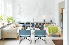 Beautiful scandinavian style home. I love the bookshelf behind so much, and subtle wall painting!