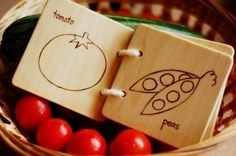 wooden books with wood burned pictures of veggies. Etsy
