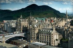 The Old Town of Edinburgh looking across North Bridge to Arthurs Seat in the Queens Park