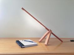A-Lamp: This beautifully handcrafted table lamp is absolute minimal. Clean modern design makes a beautiful statement sitting on your desk or as an