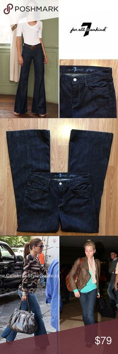 """NWOT 7 for All Mankind 'Ginger' flare denim Tapers slightly at the knee, going into a 23"""" flare leg opening for a dramatic and chic look that delivers a sophisticated 70's vibe. This beautiful deep indigo rinse allows the fabric's authentic grain to show through. Classic spice contrast stitching and luxe pale gold hardware elevate the look. Never worn. 31"""" inseam. 9.75"""" rise. 15.5"""" waist laying flat. Size 28. 7 For All Mankind Jeans Flare & Wide Leg"""