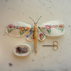 Dragon fly made from a wooden clothespin and vintage embroidered linen