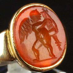 A Roman carnelian intaglio ring stone of Eros, ca 2nd century AD