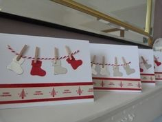 Pegged Stockings on a line pack of 4 Christmas cards £3.00