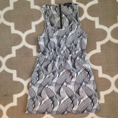 MOVING SALE❗️Black + White Pattern Sun Dress Lightly used but in excellent condition. Size small, Twenty One black and white mini sundress. Great pattern. Zip up back. Front pocket (as seen in photo 3). This cute dress would also be fabulous as a swimsuit cover up! Twenty One Dresses Mini