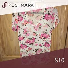 Floral V-neck from Kohls Gently worn. This shirt is somewhat see through. It is also looser fitting. Mudd Tops Tees - Short Sleeve