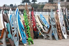 SURF BOARDS - Cut with intricate designs..One of the most creative and delightful Art shows in Central California. The Art was exceptional today. Overcast, but mild day. rcondetArt ©2017. — at Capitola Art & Wine Festival.