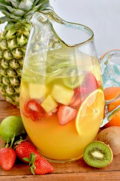 This Tropical Margarita Sangria Recipe combines sangria and margaritas in the mo. This Tropical Margarita Sangria Recipe combines sangria and margaritas in the most beautiful delicious cocktail! Wine Drinks, Cocktail Drinks, Cocktail Recipes, Alcoholic Drinks, Summer Cocktails, Beverages, Easy Cocktails, Traditional Sangria Recipe, Margarita Recipes