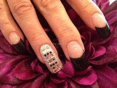 Black gel polish tips with Swarovski crystal nail art