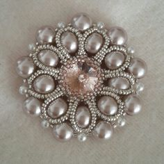 My bezelled rivoli pendant with lovely pearls / beaded by Emel Bas