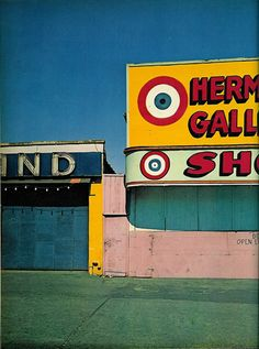Coney Island shooting gallery by Evelyn Hofer