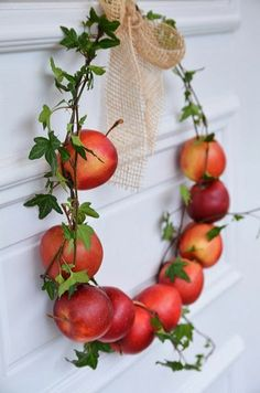 Wire through apples, wrap ivy around both and then add simple burlap bow.  Very nice.