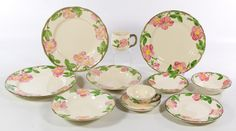 """Lot 445: Franciscan """"Desert Rose"""" China Service; Having (4) dinner plates, (4) salad plates, (10) dessert plates, (4) saucers, (4) coffee cups, (6) tea cups, (5) berry bowls, (1) soup bowl, (2) oval platters, (3) round serving bowls, a covered round casserole, a covered sugar bowl, a creamer, a pair of salt and pepper shakers, a covered cookie jar, a rectangular casserole and a large vase; set has four different back stamps"""