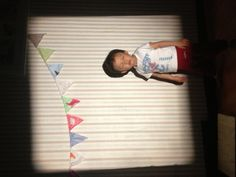 my husband's #vintageprojector    and my handmade #partybanner  and  my son