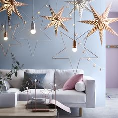 Light up your home for the holidays with decorative IKEA lighting, like the STRÅLA LED table decoration and pendant lamps.