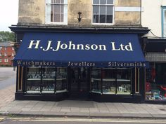 H J Johnson in Devizes with their new beautiful sign written cover to their Victorian Shop Blind by Deans Blinds And Awnings
