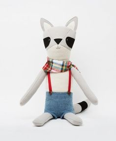 Raccoon Toys -  two-foot-tall Chester the Raccoon ($98) is made of soft brushed wool, has a hand-embroidered face, and is dressed in a plaid flannel bandanna and chambray overalls.