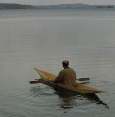 """Check out this amazing 18' canoe made from a single sheet of plywood. Resembling a South American """"pipante"""" dugout canoe, Finnish boat builder Hannu Vartiala designed and built his craft, """"dug"""", in an attempt to correct balancing issues he had with a previous design. He's also put up instructions on his site so you can build your own. It sure is an impressive example of maximum use of materials with minimal effort."""