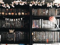 I'm still hoping to get to a bookshelf tour sometime soon, but here's part of the black section for now!