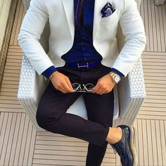Paul Smith shoes and shirt, Rolex gold watch, Hermes belt, Tom Ford blazer