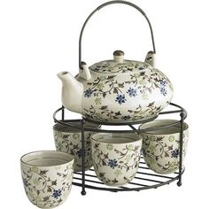 Tomoko Teapot Set:A delicate porcelain teapot. Four matching teacups. And a special stand from which to pour, then store