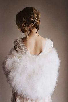 Beautiful bride in Boris Pavlin romantic wedding dress.