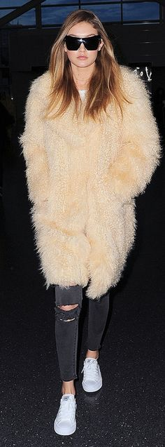 Fashion Faceoff | People - Gigi Hadid in a fur Elizabeth and James coat and skinny ripped black jeans