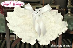 dreamingincolor: How to make Angel Wings  ~  for the back of the dining room chairs or you could make it a wreath. Pretty!
