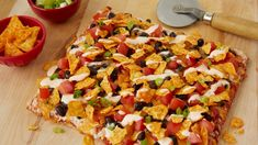Dinner ready in 30 minutes! What a fun way to have a nacho party on a pizza using Totino's® pepperoni pizza.