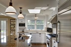 Yankee Barn Houses with Crown Point Cabinetry Kitchens