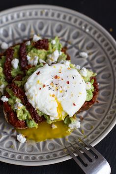 Harissa, Smashed Avocado + Egg Toast with Goat Cheese and Honey Drizzle