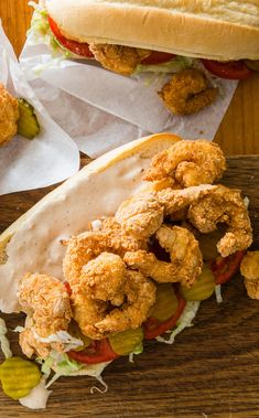 Shrimp Po' Boys: If a trip to Louisiana isn't in the cards, our Shrimp Po' Boy recipe will give you a good substitute right at home. A three-step process of dredge-dip-dredge makes the batter stick to the shrimp and boost crunchiness. Po Boy Sandwich, Shrimp Sandwich, Poboy Sandwich Recipe, Shrimp Burger, Sandwich Ideas, Sandwich Recipes, Fish Recipes, Seafood Recipes, Seafood Dishes