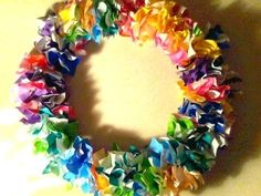 """Inspires an idea for preschoolers: cut out a """"wreath"""" from cardboard (flat) & have them crumple tissue paper to glue on, in holiday colors 