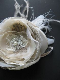 Vintage fascinator Wedding feather hairpiece Rustic burlap bridal flower shabby chic clip lace Beige champagne taupe Ivory Fascinator. $36.00, via Etsy.