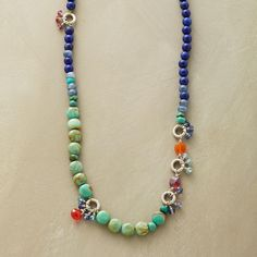 """BLUES FESTIVAL NECKLACE--A blue and multicolored gemstone necklace, wherein lapis and turquoise play the blues while little groups of glittering stones; iolite, kyanite, carnelian, red jade and apatite; dance to the beat. Leather loops with sterling silver button closure. Exclusive. 18"""" to 19""""L."""