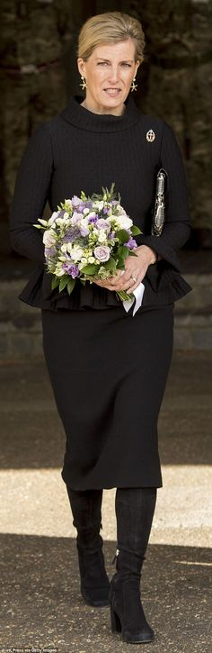 Sophie, Countess of Wessex, wore a classic black suit with a snakeskin clutch and suede bo...