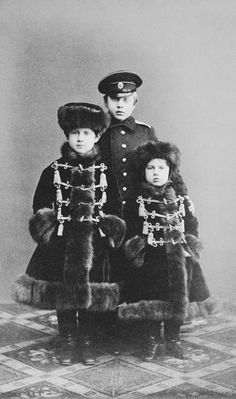 """""""Three little Konstantinovichi Grand Dukes: Konstantin, Dmitri and Vyacheslav in about 1866. While Dmitri and Vyacheslav are wrapped in warm winter clothes, the eldest Konstatin is always wearing a uniform. """""""