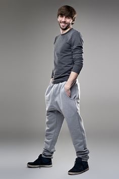 Mens must have unisex low crotch joggers in grey worn with long sleeve charcoal top. Find on www.diddiu.com