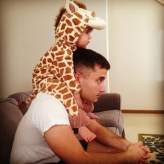 The giraffe outfit is adorable! And I bet our future child will sit on his shoulders like this, too cute