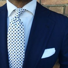 "Suited with a ""White Multipattern"" silk tie from Viola Milano"