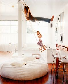 indoor swings- this room looks like so much fun. I love the big floor pillow/chair too!
