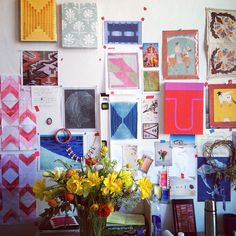 Paintings in progress, art images, textiles. Studio of artist Lily Stockman.  (Inspiration board/mood board/picture wall, artist studio/office.)